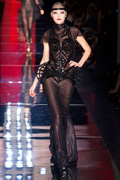 This dress is topped with the custom-made Madonna corset that I would take up supervillainy to own. (JPG Fall 2012 Couture)