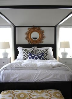 Neutral Master bedroom decor:  black bed, white walls, white bedding and gold accents (mirror, upholstery).  This is so similar to our color scheme, except we don't have white bedding or lamps.  I love neutral color schemes :)