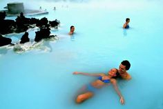 Honeymoon-- The Blue Lagoon, Iceland, is a geothermal spa. The outdoor bath remains 100-110°F year round. The natural ingredients of the warm water: mineral salts, white silica and blue green algae. These ingredients clean exfoliate, nourish & soften the skin while relaxing the body.