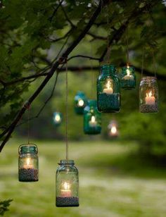 Lots of trees around the barn to hang these cute lanterns on! Filled with sand for a lake-theme wedding, of course!