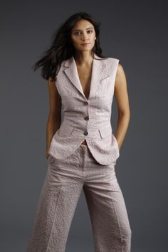 Graphic patterns and novel silhouettes — vests or blazers worn with ankle-grazing pants or shorts — add interest to pantsuits for resort.