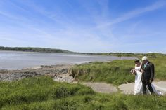 Walking down the aisle at an Irish outdoor seaside destination wedding. AislinnEvents.com photo by Emma Jervis