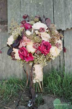 There is a little bit of everything in the stunning bouquet....roses, hydrangea, poms, scabiosa pods, seeded eucalyptus, sunset safari protea.