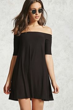 A knit dress featuring an off-the-shoulder design, short sleeves, and a skater silhouette.
