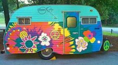Love this painted caravan! Hippy style flower power vintage camper - sweet <O>