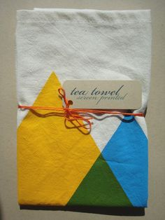 hand screen printed tea towel. blue and yellow makes green triangles.. $16.00, via Etsy.