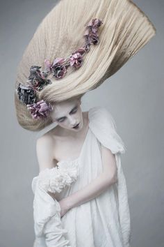 Love the hair and dress and flowers Avant Garde hair.