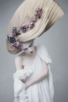 Love the hair and dress and flowers Avant Garde hair.
