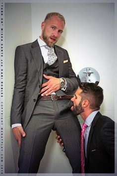 Men having sex in suits