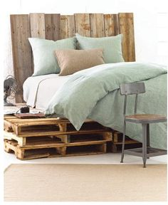 Pallet bed shown with Pine Cone Hill Chambray Linen Ocean Duvet Cover & Shams