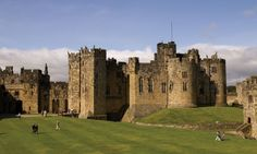 """Alnwick Castle (pronounced """"Annick"""") is one of England's largest inhabited castles. If it looks familiar, you may have seen it on the big screen — it's appeared in a number of films, including """"Elizabeth"""" and the first two Harry Potter movies. (Remember the scene where Harry first learns to fly a broom?) Visitors can tour a number of elegant state rooms — don't miss the enormous library."""