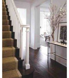 Dark wood floor hallway entry table
