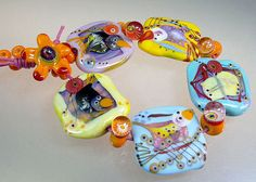 Storyteller Beads - Birds and Cats and flowers ... all handmade lampwork glass by Manuels Wutschke.