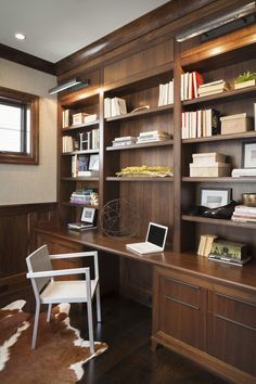 Office Space with Wooden Shelving and Animal Rug | Elizabeth Krueger Design