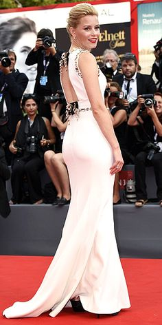 "People's 2015 Best Dressed List: See All the Winners | ELIZABETH BANKS  | What's something all the Pitch Perfect 2 director's looks have in common? They're as fab from behind as they are from the front. ""She does a back shot better than anyone,"" says Wendi Ferreira, who styles Banks, 41, with her sister Nicole. This Dolce & Gabbana gown is a perfect example."