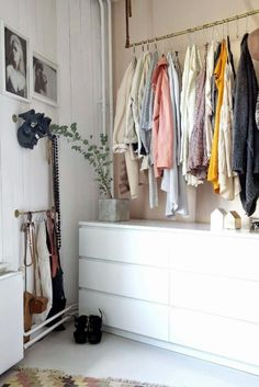 Join forces. If hanging a clothing rod won't suffice for your whole wardrobe, add shelving or a dresser with deep drawers to help contain the couture.