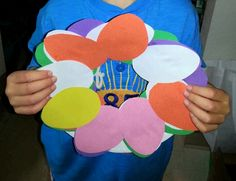 Easy pre-school craft. Cut out center of a paper plate, let child glue egg shaped construction paper cut outs to the remainder of the plate, let dry. Remember to add name and date to the back.