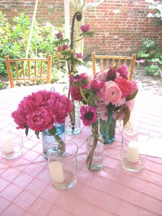 Bright and colorful centerpieces by Buttercup for Samantha & David's garden party wedding at Physick House