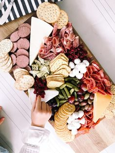 Lisa Allen of Salty Lashes daughters make a meat and cheese board