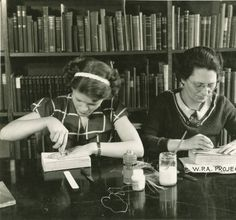 WPA Project Number 123 - Book repair at the Enoch Pratt Free Library in Baltimore, workers using awls and sewing bindings