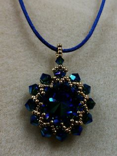 Made by beadweaving seed beads and bicones.Just Beading Around - Bead Store in Epping, NH - Classes Beaded Necklace Patterns, Beaded Jewelry Designs, Bead Jewellery, Jewelry Necklaces, Handmade Jewelry, Beaded Brooch, Beaded Earrings, Beaded Bracelets, Imitation Jewelry
