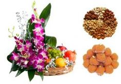 Exclusive fresh seasonal fruits 1000 gms. (grape, apple, pomegranate, orange etc.) combination with orchid arrangement along with 500 gms. pure ghee laddu and 500 gms assorted dry fruits (cashew, pistachio, raisins, almonds etc.) - Send this exclusive gift to your loved ones through us.