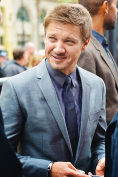 Ugh. That suit and that hair and the adorable smile. Why must you do such things to my heart, sir?