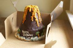 Volcano cake Dinosaur Cake, Dinosaur Party, Happy Birthday Leo, Volcano Cake, Mad Scientist Party, Cake Stock, Tiki Party, Cake Board, Novelty Cakes