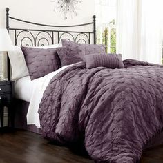 "4-piece cotton-blend comforter set with embroidered detail.   Product: Queen: Comforter, bedskirt and 2 standard shamsKing: Comforter, bedskirt and 2 king shamsCalifornia King: Comforter, bedskirt and 2 king shamsConstruction Material: Cotton-blendColor: PurpleFeatures: Embroidered details14.5"" Bedskirt drop Dimensions: Standard Sham: 20"" x 26"" eachKing Sham: 20"" x 36"" eachQueen Comforter: 90"" x 92""King Comforter: 92"" x 102""California King Comforter: 92"" x 110"" Note: Accent pillows not incl…"