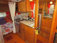 Decked out red vintage Shasta interior