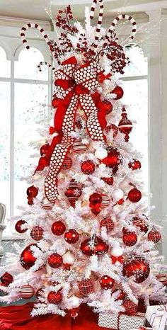Beautiful Red and White Christmas Tree with Candy Cane Topper.