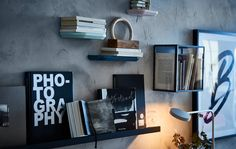 Love the written word? Show off your books with a gallery wall using display boxes and picture ledges like a black MOSSLANDA picture ledge from IKEA. It makes a mini shelf, where you can place books and admire their covers. It can hold 16.5 lbs, too.