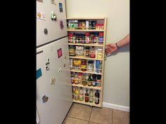 Make use of the space next to your fridge and make a slide out pantry.