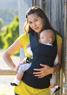 Beco baby carrier. Good for mom's with bad backs, and fits babies 7-35lbs doesn't need new born inserts.