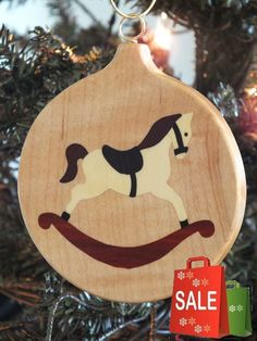 Beautiful Marquetry wood inlay Christmas ornament of Rocking Horse. Inlay woods are Ebony, Holly, Redheart and Rosewood, background wood is quilted