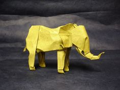 Montroll's fantastic elephant diagrammed in Origami Inside Out.  Folded from: one 30 cm square of elephant hide Size: 14 cm long from nose to tail Time spent folding: ~2 hours