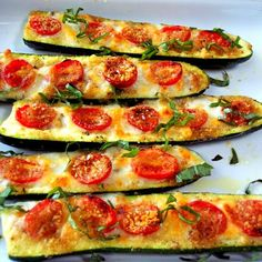 Zucchini boats with roasted tomatoes, cheese, and basil
