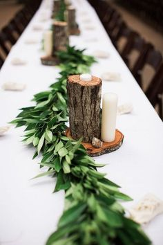 greenery and tree stumps wedding centerpiece ideas #weddingideas #weddingdecor #rusticwedding #countrywedding #weddingcenterpiece