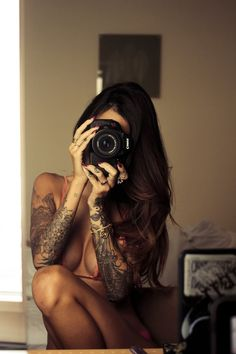 tatto photographer girl - love the idea of a nature scene for the upper arm. http://www.facebook.com/pages/Art-of-street/144938735644793?ref=ts=ts