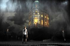 An Inspector Calls, 1992    This was the design that remade a play. For Stephen Daldry's 1992 production, influenced by expressionism and film noir, Ian MacNeil suggested the collision of eras and classes in Priestley's drama, written towards the end of the second world war but set in 1912. The precarious home of a bourgeois family was perched on stilts; its walls swung open like those of a doll's house; its proportions were skewed, its inhabitants seeming to bulge out of it. Outside, childr...