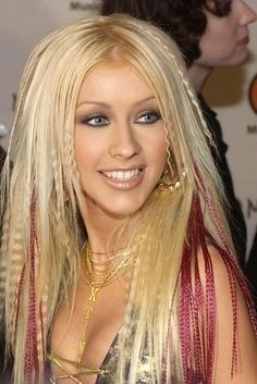 Burning off a chunk of hair trying to crimp it so it looked just like Christina's. | The 22 Worst Parts Of Being A Girl In The Early '00s