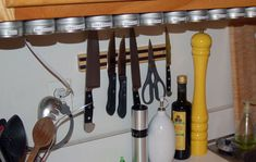 I take it back - I'm gonna do my spices like this and save space! :)  sooo cool! Build this space rack out of a metal ruler! Great idea!!!!!  :)