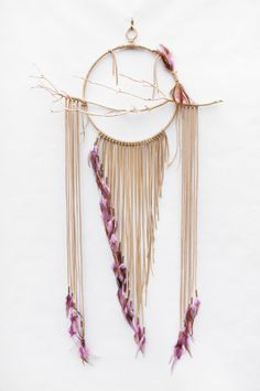 Handmade, modern dreamcatcher art. The center hoop is 10 inches in diameter, the center branch is 20 inches across and is 3ft long from top to bottom. The Sunbird is made using tan suede lace with a sandblasted manzanita branch and lavender/brown rooster hackle feathers. At the heart