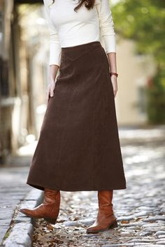 Long brown skirt and tall leather boots...lovin it!  Want fall back now!