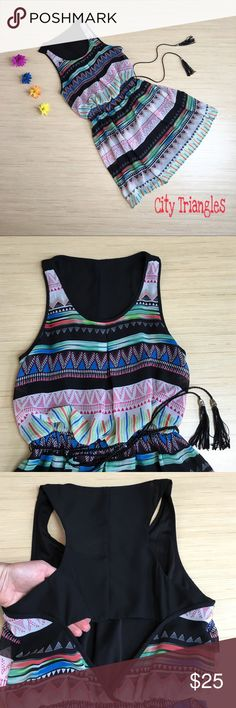 City Triangles Dress NWOT Size Small Slay this summer in this beautiful and unique dress by City Triangles! The front top of the dress has a blousy effect before it cinches in at the waist with elastic. Around the waist there is also a braided belt with silver beads at the ends. The racerback of the dress is sheer and below that is a keyhole that exposes the lower back. The dress is fully lined, expect for the racerback. The dress is made of 100% polyester. It is also NWOT and is a size…