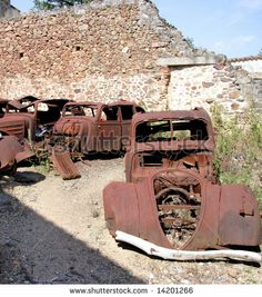 stock photo : Old Rusting Car wrecks abandoned in a yard