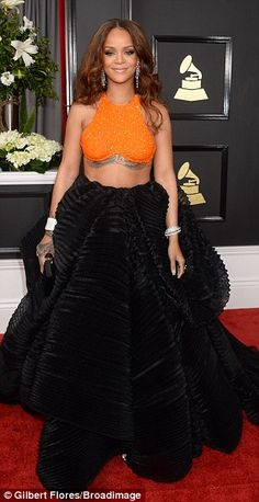 Here come the divas!  Jennifer Lopez, Adele and Rihanna dominated the red carpet at the 59th annual Grammy Awards on Sunday
