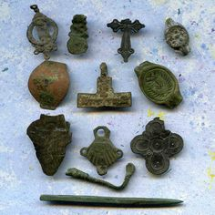 "archeological Instant Collections, antique strange objects, oddities, from a private dig, coolvintage, metal patina, old, age. They are a total of 12 strange objects with the largest being 1 1/8"" and 2 5/8"" long"