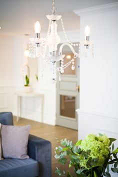 Classic #chandelier lighting in the living room. By designer Kate. Get matched with the right design professional for your home project on www.designforme.com