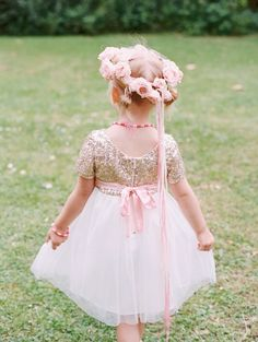 Flower girl inspiration. Pale pink roses create this little girls flower crown with a golden sequin dress. For more inspiration visit www.weddingsite.co.uk